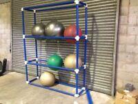 yoga / swiss ball shelving unit plus old and new swiss balls