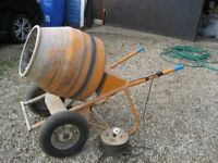Electric wheel barrow type cement mixer.