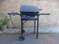 Calor gas barbeque. Has side burner and wheels for easy movement.