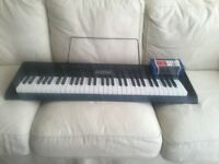 Casio CTK- 2300 portable keyboard with a power adapter