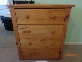Solid pine 4 drawer chest.