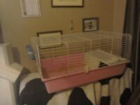 Indoor rabbit cage. Has house and water bottle. L.37 inches, D.22 inches and H.17 inches
