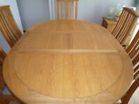 Dining Table and 6 Leather covered Chairs