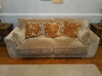 2 x three seater sofas and round revolving chair with moon shape stool