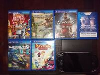 Playstation Vita (OLED Model) with x2 travel cases, 5 GAMES and 16GB Memory card