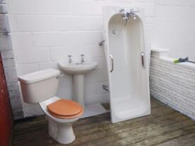 Bathtub, basins, toilet and taps in pale avocado. Good condition. 100.oo pounds or near offer.