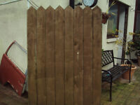 A pair of wooden side gates.
