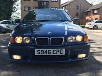 BMW 328i touring with the M50 2.5 engine.