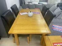 EXTENDABLE DINING TABLE AND 4 BLACK LEATHER CHAIRS. £299