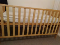 Baby cot with white colour mattress attached