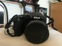Nikon Coolpix L810 Digital Camera with charger, strap, memory card, computer software