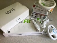 Wii, wii fit board, guitar hero with guitar and selection of games