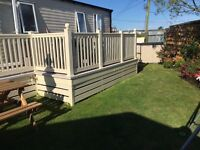 Luxury caravan at Seawick holiday park with private garden area