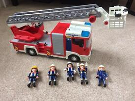 Playmobil fire engine and people.