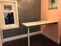 White glass effect breakfast bar or worktop from Howdens with trim