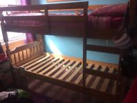 Pine bunk bed with ladder, pre-owned.