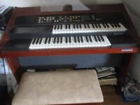 Hohner E2 organ .2 keyboards and pedals. Stool also.