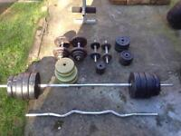 Larege selection of cast and plastic York weights, dumbells, different bars and Free bench.