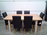 Ex display bargain extendable dining table and 6 chairs. Black and oak cols, can deliver.