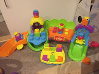 Fisher Price Songs & Smiles Silly Town with Stack 'n' Surprise Blocks & Extra Music stacker