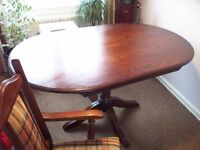 solid oak dinning table and chairs by wood brothers england