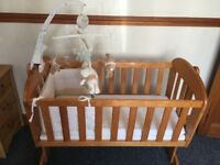 Baby swinging crib with 2x mattress, fitted sheet and cot mobile for only £20.