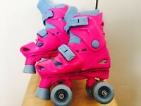 Adjustable pink roller skates