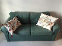 Comfy green sofa bed
