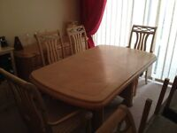 Extendable dining table & 8 chairs £200