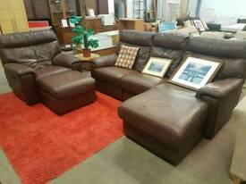 Large brown leather corner sofa with reclining chair and footstool