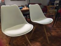A pair of elegant white office or dining chairs from MADE