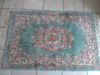 Rug for sale.Green,cream and pink good condition. 180x122cms Buyer collects.
