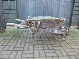 WOODEN WHEELBARROW VICTORIAN VARIOUS USES IN GOOD CONDITION FOR AGE CAN STILL BE USED £40 NO OFFERS