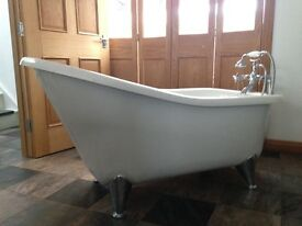 Freestanding, mounded Acrylic, Rolltop Slipper Bath.
