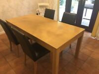 Oak effect dining table and 4 brown faux leather chairs