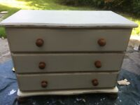 Lovely ivory and distressed painted and waxed lie chest of drawers.