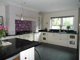 Ivory kitchen with black granite worktops for sale. Excellent condition.