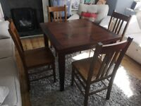 Bargain 4 seat wooden dining table and chairs with extendable table