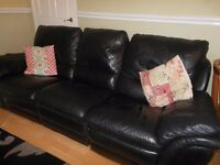 Black Leather 3 Seater Reclining Settee.
