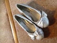 Girls silver glittery shoes wth diamanté bow detail. Size 1