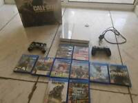 Ps4 for sale with 9 games comes with box
