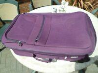 large suitcase in purple