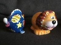 Fish and lion piggy banks