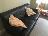 Small black leather sofa