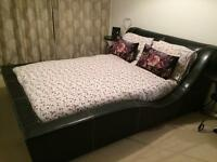 Black leather double bed