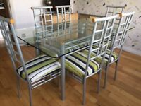 Glass Dining table plus 6 chairs and mirror