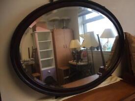 Vintage large mahogany oval mirror