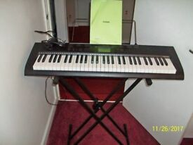 Casio organ ctk 1150 with stand and music book excellent item many tunes and beats
