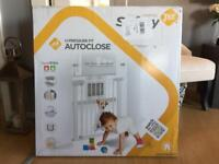 Safety 1st auto close baby gate. Brand new unopened.