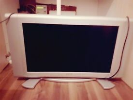 bush 28inch tv with Panasonic dvd player and glass tv stand
